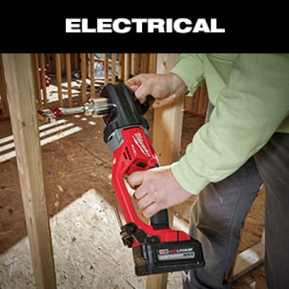 Man uses the M18 FUEL SUPER HAWG  Right Angle Drill to drill into wood beam on jobsite.
