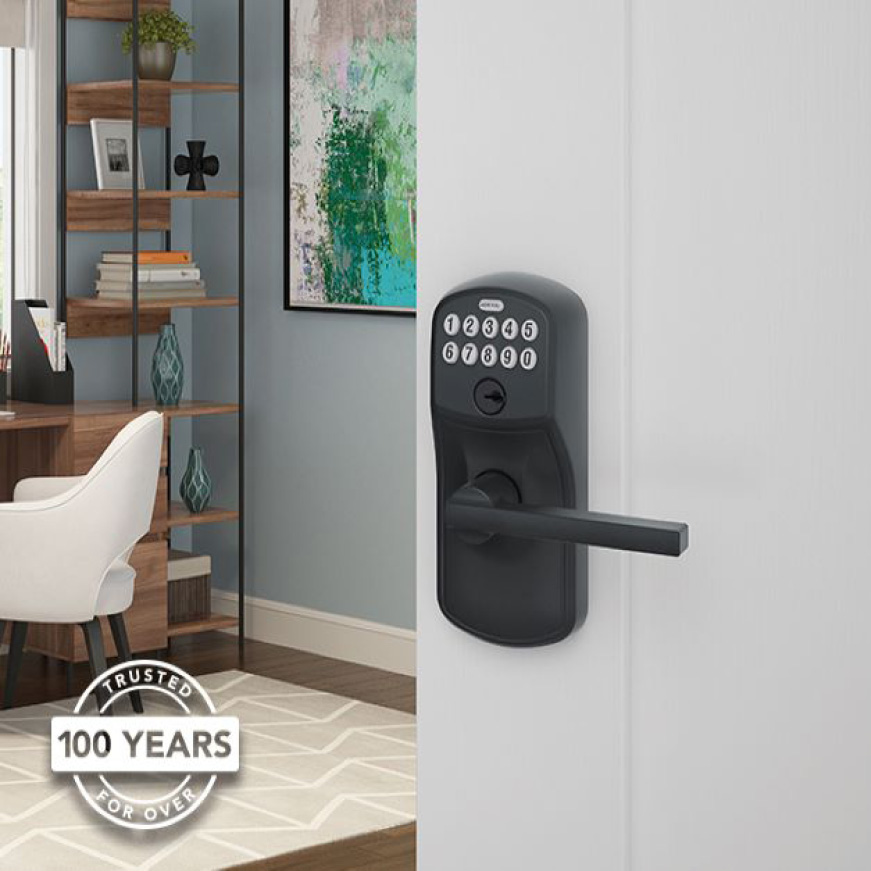 Schlage Plymouth Matte Black keypad Latitude lever on white office door.