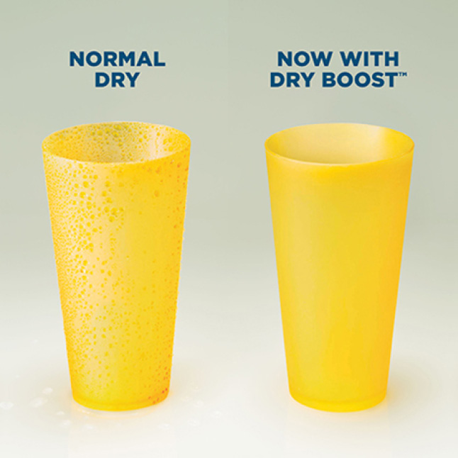 Two yellow cups sit next to each other after running through two separate cycles. The normal-dry cup is still wet, but the dry boosted cup is dry.