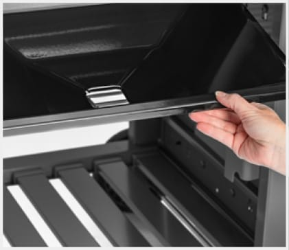 Excess drippings are funneled away from the burners into the disposable drip tray in the catch pan. Simply remove the catch pan and replace the tray.
