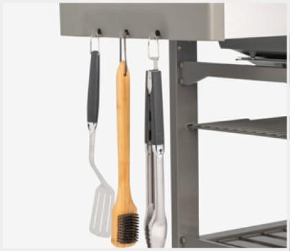 Hang your tools on the hooks for easy access and organization.