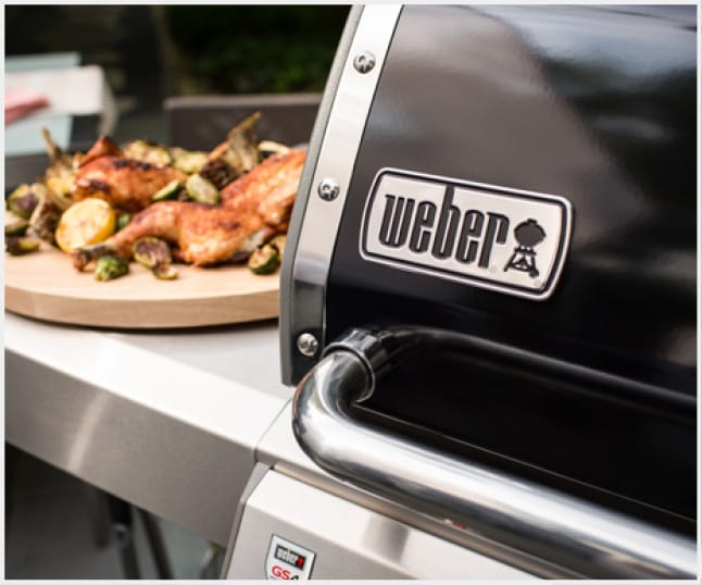 Porcelain-enameled lid retains heat and protects your grill from the elements.
