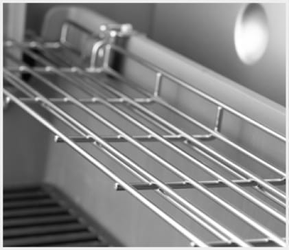 Warming rack keeps food warm while the main course finishes grilling. Folds down when not in use.