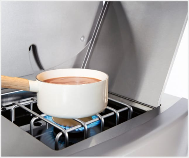 Use the side burner to simmer sauce or sauté veggies while the main course grills under the lid.