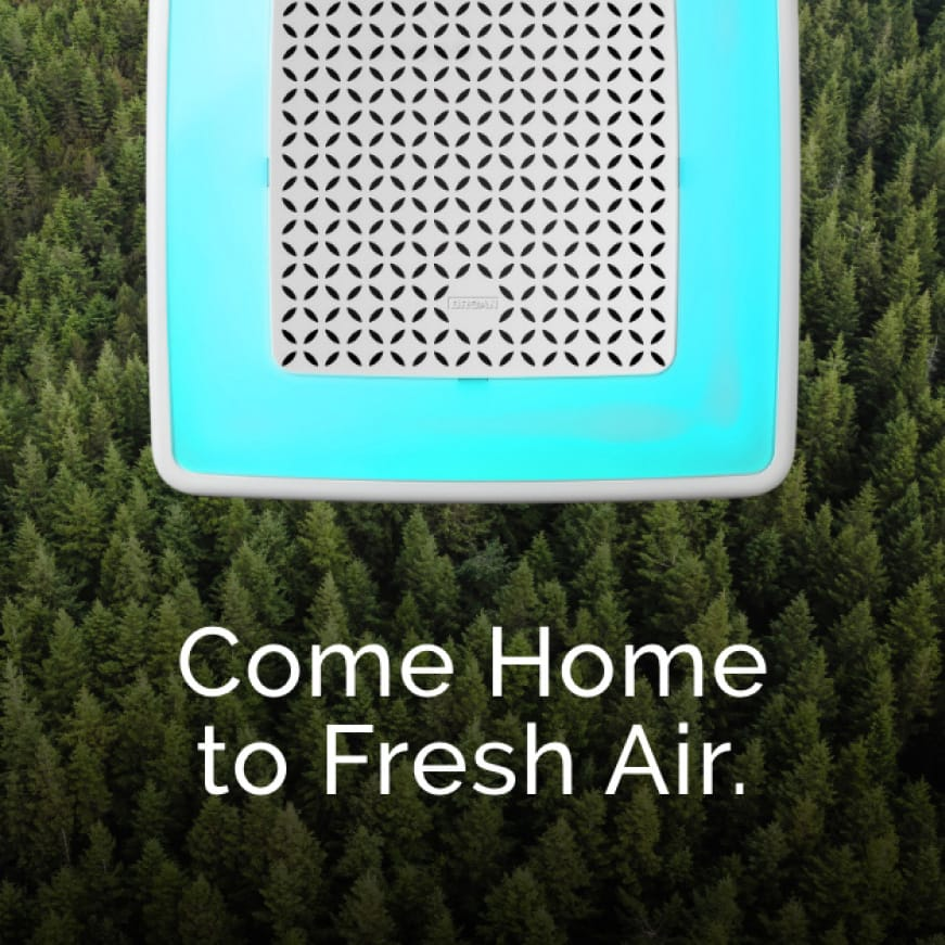 Image of white ChromaComfort fan grille illuminated in a turquoise blue on top of evergreen trees. Words on top say: Come Home to Fresh Air.