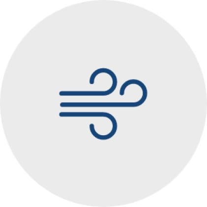 Blue icon of three horizontal lines that curl up on the right side to represent wind blowing.
