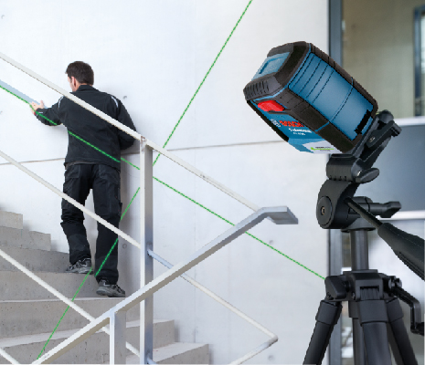 Bosch GLL 40-20 G locked and angled on tripod to align with stair railing.