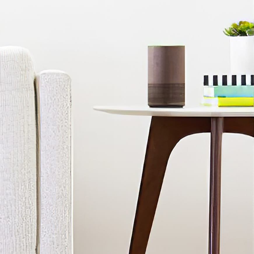 A smart device sits on a modern table, waiting for instruction.