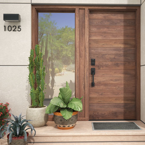 Schlage Connect Smart Deadbolt in Matte Black on modern wood front door.
