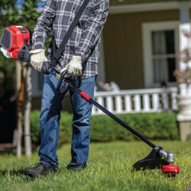 Troy-Bilt gas string trimmer cutting swaths