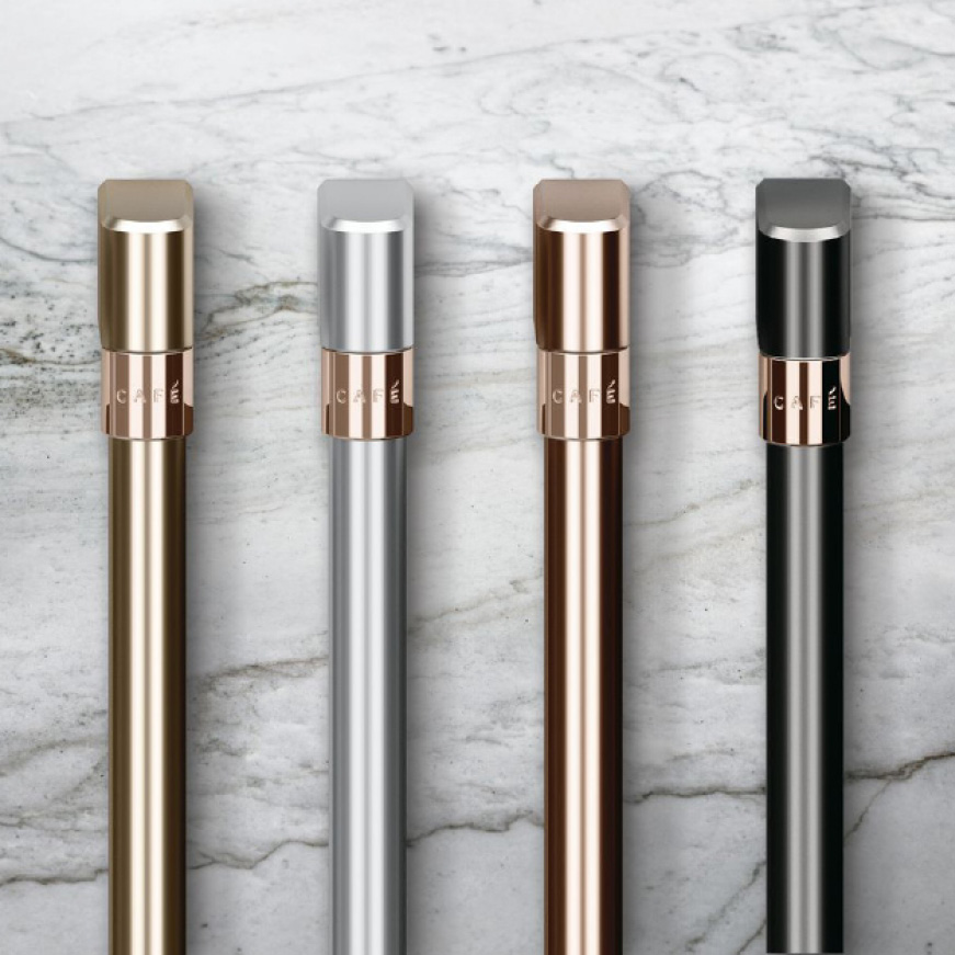 Four different color handle options on a marble background