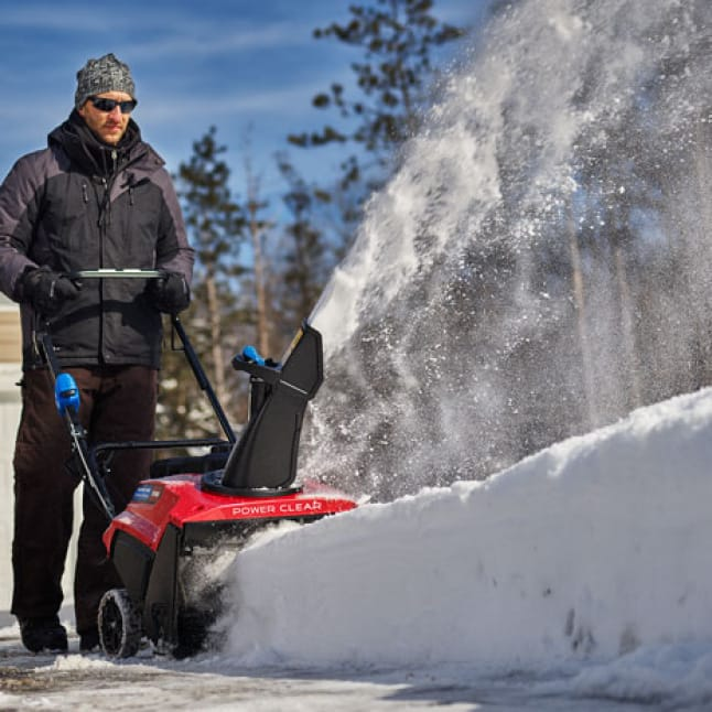 images shows the snow blower slicing through thick snow
