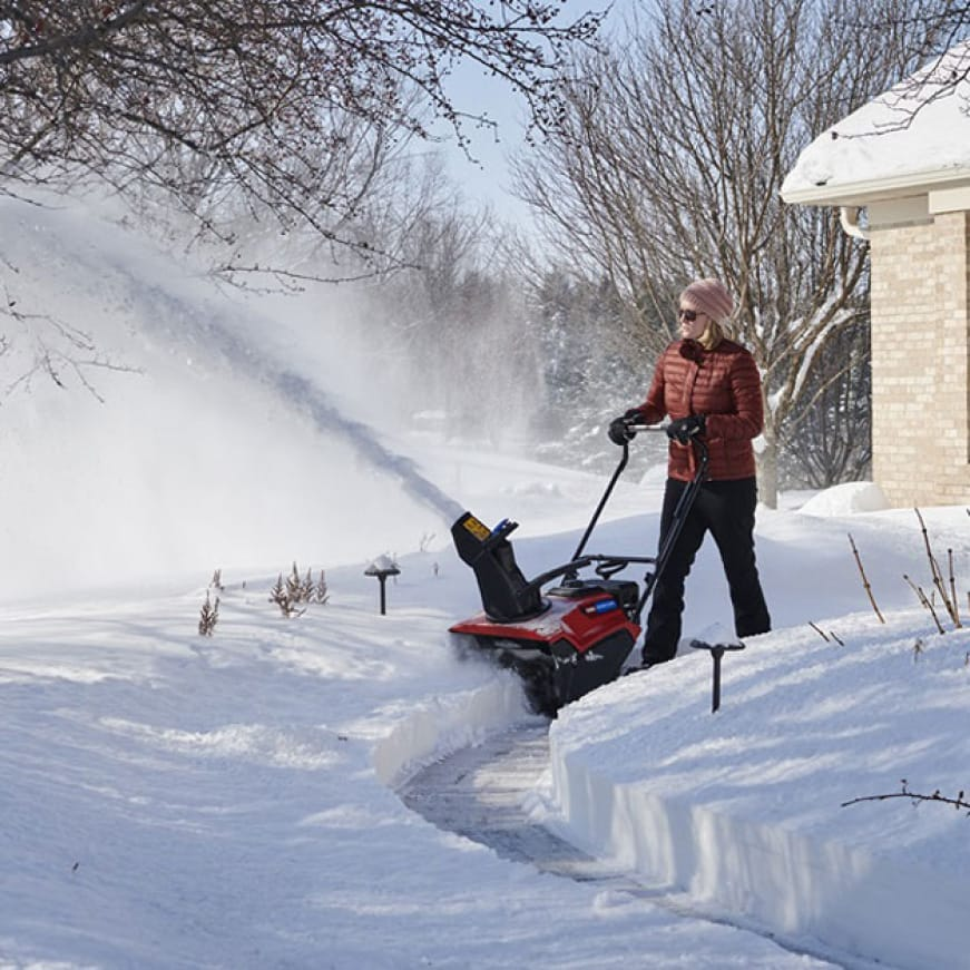 image shows how snow blower shreds through snow while reducing clogging