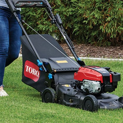 side view of the lawn mower showing the versatility of mulching, bagging or side discharge option