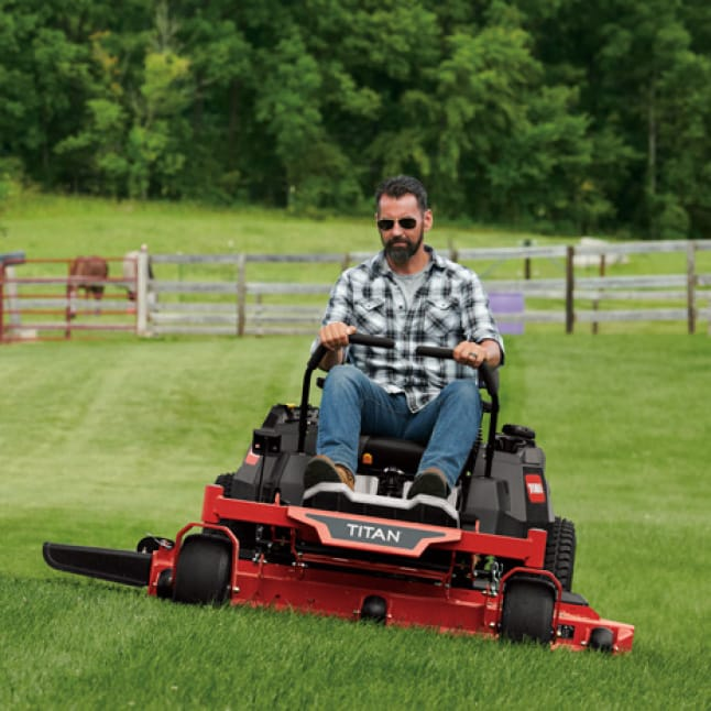 image of homeowner with acreage tackling their land with their TITAN