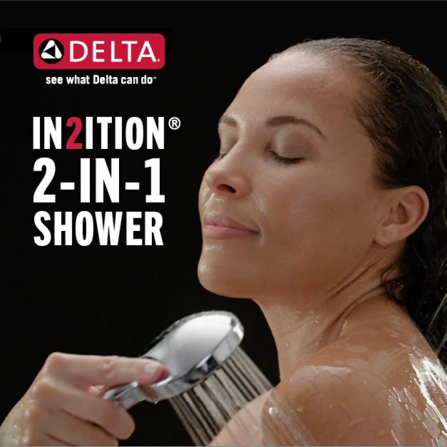 "Image is of a female model showering (shoulders-up) with a hand shower and copy ""In2ition 2-in-1 shower"""