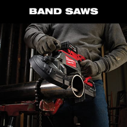 Man wearing work gloves uses the M18 FUEL Dual-Trigger Band Saw to cut a metal pipe.
