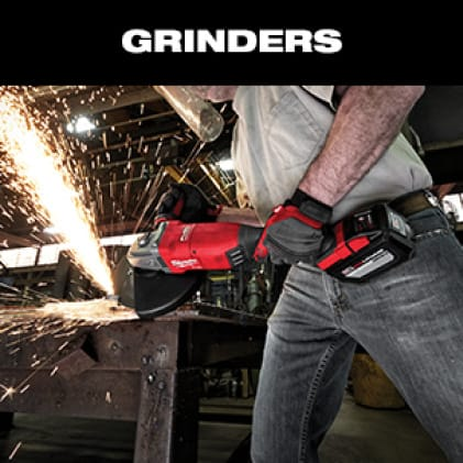 A man in jeans and gray t-shirt wearing work gloves uses an M18 FUEL Braking Grinder on metal as sparks fly.