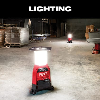 Two M18 RADIUS Site Lights sit on job site floor illuminating the workspace.