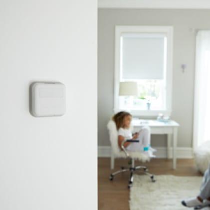 Smart sensor mounted on bedroom wall