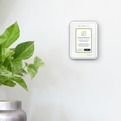 Energy savings event displayed on thermostat