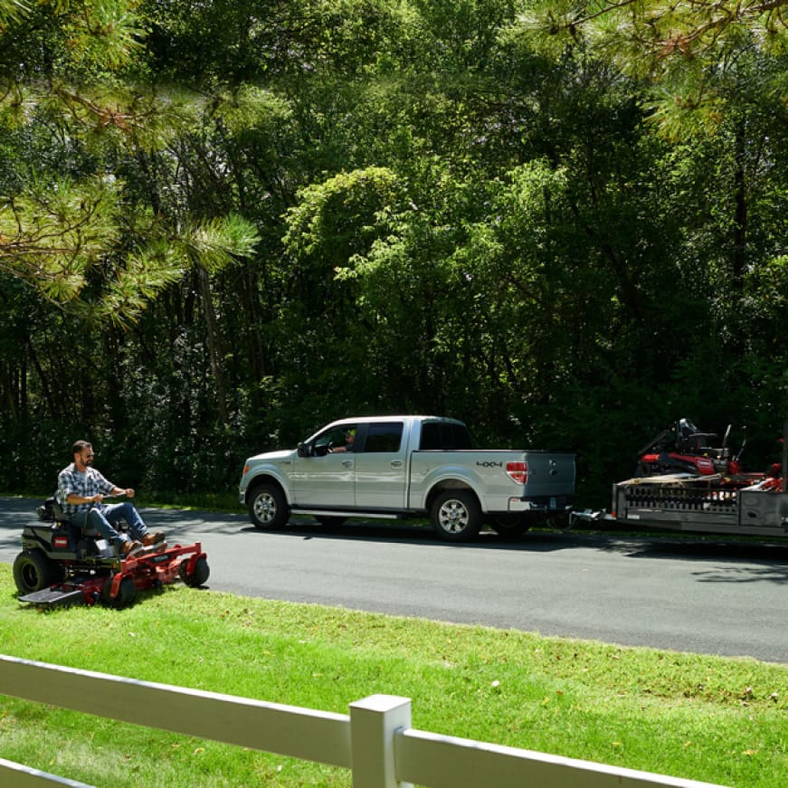image shows happy Toro homeowner cutting grass and professional landscape contractor with their own professional Toro zero turn mower