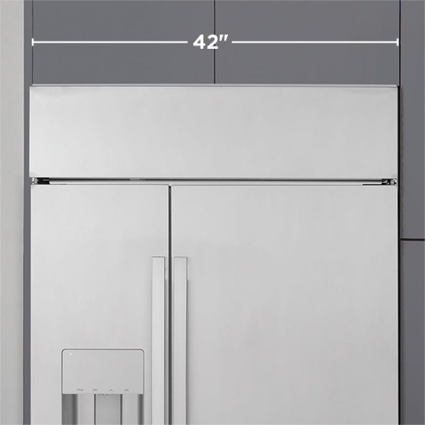 Tight shot of built-in refrigerator installed in cabinets