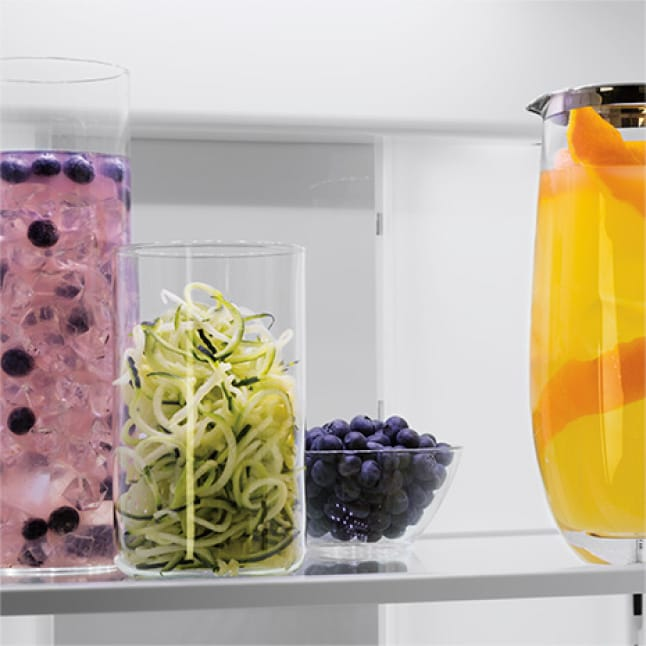 LED lighting illuminating glass containers filled with fresh produce and mixed drinks
