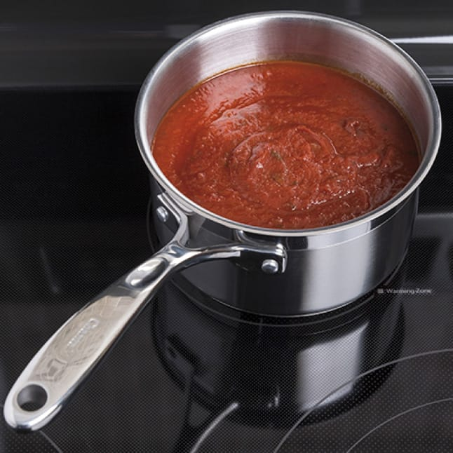 Red sauce is kept warm and ready to serve over the fifth element warming zone.