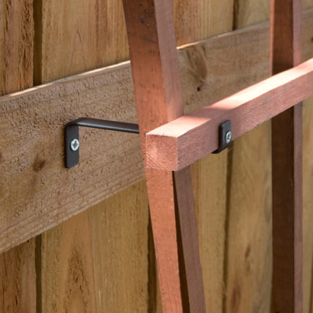 A close up view on showing how a trellis bracket supports a trellis
