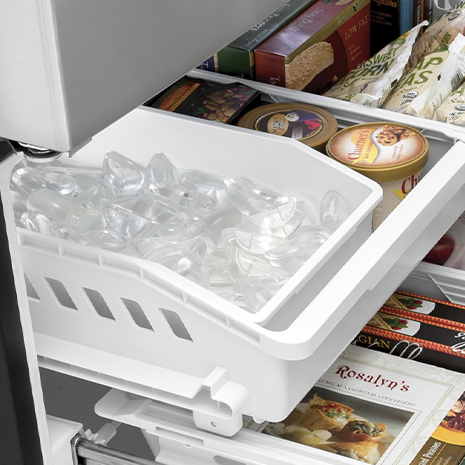 An ice maker in the freezer is installed in the left half of the freezer's top drawer.
