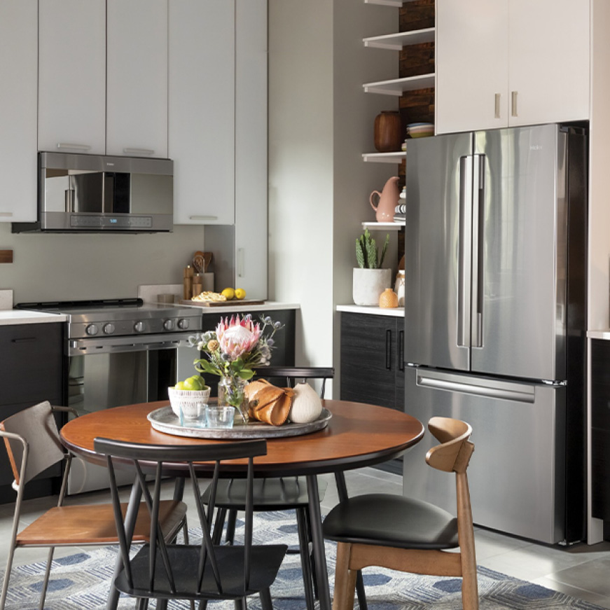 Haier appliances are installed in a modern, stylish kitchen.
