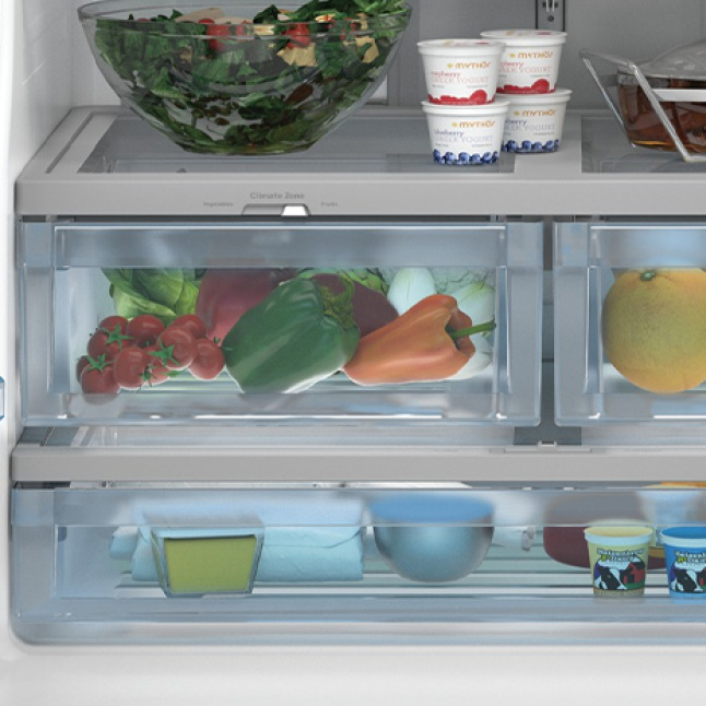 A close-up of the deli drawer. Several foods are stored inside the clear blue bins.