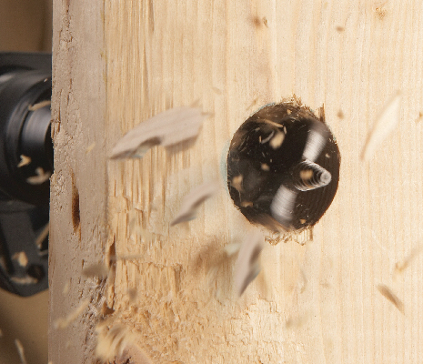 Bosch Daredevil spade bit tip drilling hole through wood.