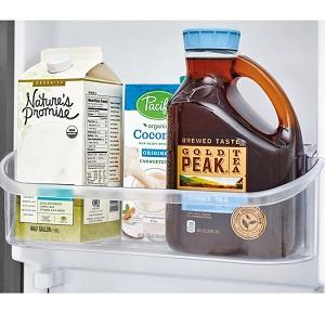 Sweet tea and milk in refrigerator door.