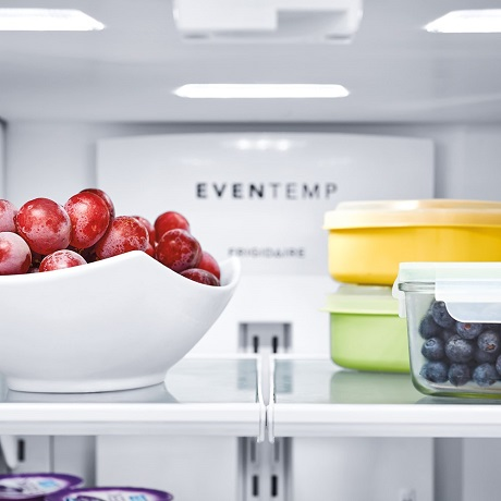 Fruits and berries inside refrigerator