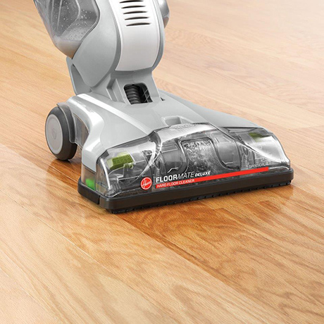 Up close view of the Hoover Professional Series FloorMate Deluxe Hard Floor Cleaner being used on hardwood floors.