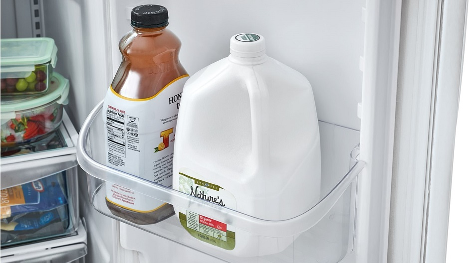 Gallon of milk in refrigerator door.