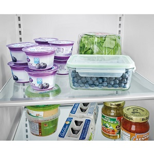 Food on glass shelves in refrigerator