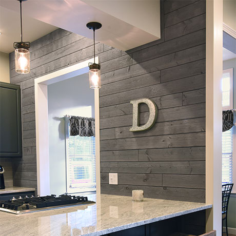 Grey Barnwood Shiplap Board Used As An Accent Wall In The Kitchen