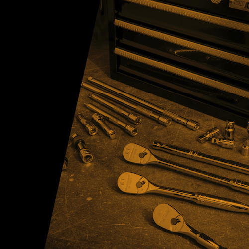 84-Tooth mechanic's tool sets on workbench