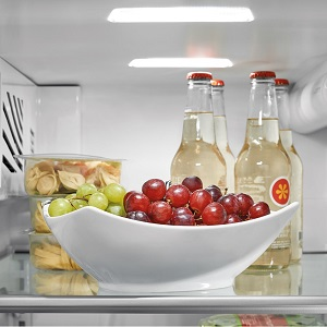 Food and drinks on top shelf of refrigerator
