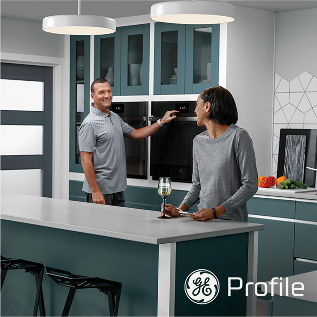Beauty shot of talent in kitchen interacting with product.