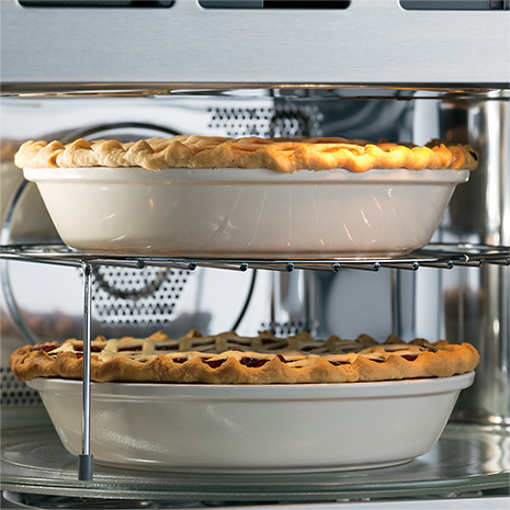 Image of two pies on rack and turntable inside oven cavity