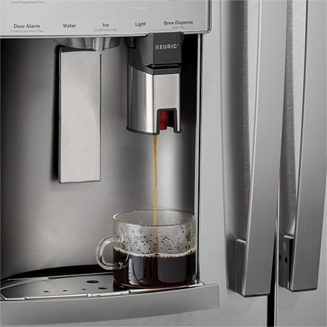 Keurig brewing hot coffee into glass mug