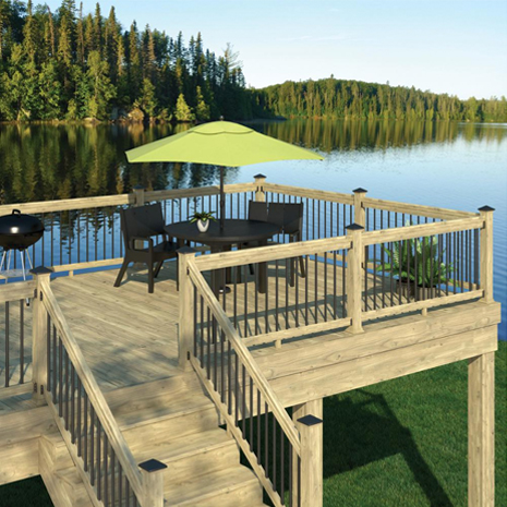 An beauty shot of a deck overlooking a lake featuring the 6 ft pressure treated rail kit with round aluminum balusters