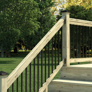 A lifestyle image of the contemporary balusters installed on a deck and stair railing