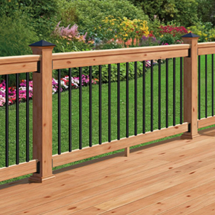 A lifestyle image showing a deck railing using the round balusters