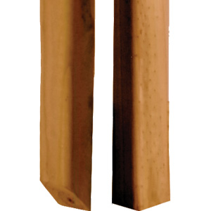 Close up of a pressure-treated B2E baluster and square edge spindle