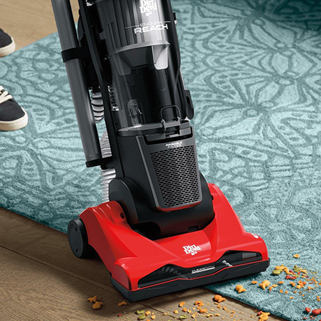 Close-up view of Dirt Devil Endura Reach Upright Vacuum cleaning dirt off carpet and hardwood floor showing the benefits of multi-floor brush.